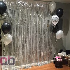 Sliver, black and white theme photobooth. Coordinated by Amrita Bhogal Events.