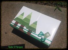 Paint Sample Christmas Tree as Gift Wrap - Christmas Trees made from paint sample cut apart and trimmed with a paper punch. Tree trunks were cut from a magazine ad. I liked the different textures. The box was green with writing so I only wrapped the white to cover up the writing.