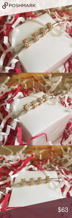 ♥️ FLASH SALE ♥️ PANDORA Trinity Flowers Spacers like new condition  4 available   CHEAPER ON MY WEBSITE  https://www.facebook.com/styleupscaleboutique/  Delicate 14K gold flowers make up this charm. Each flower has been carefully cut out to create an openwork design. The charm would be the perfect addition to a floral-themed bracelet! Pandora Jewelry Bracelets