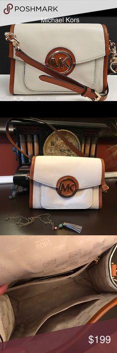"Michael kors crossboby handbag Margo luggage vanilla leather messenger cross body handbag. Appprox. 9"" (L), 6.5"" (H), 4"" (D) like new. 21"" drop.  Used very little no marks on the inside. The MK emblem has a few scratches. Michael Kors Bags Crossbody Bags"