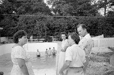 Gladys Talks To Neighbors-   Gladys, Elvis Presley's mom, having recentlymoved into their new house speaks with some ofher neighbors on this July 4, 1956 holiday, whileElvis and friends are cooling off in the pool.1034 Audubon Dr., Memphis, TN.