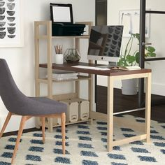 Bring stylish simplicity to your workspace with this contemporary writing desk, showcasing open storage and a 2-tone finish.