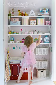 Combined play kitchen and storage space in a little nook