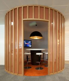 Meeting Rooms >> Cool Meeting Spaces >> Bespoke joinery has been used to create this cool #meetingpod. This circular huddle space is a perfect spot for #collaboration. Colleagues can connect to the flat screen display or simply chat around the circular #huddleroom table. Using timber and #bespokecarpentry is a great way to add #biophilicdesign elements to your #officedesign.... See more great #meetingrooms and #coolmeetingspaces on our website...