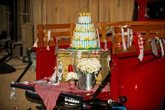 The back of an old truck is a very unique cake display table!
