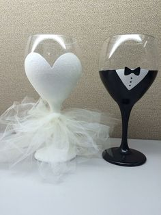 20oz Glittery Bride hand painted wine glass with tulle dress and hand painted Groom's glass. Created by LessThanThree Designs www.facebook.com/lessthanthreedesigns.