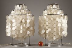 "Pair of original ""Fun"" table lamps designed by Verner Panton (1926 - 1998) in the 1960's, manufactured by J. Luber. Each lamp is composed of a round metallic structure maintaining three mother-of-pearl curtains of shells."