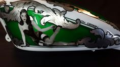 Aerografia Serbatoio harley davidson tank made with candy color ,pin up , silver leaf and pastel color . Candy Colors, Pastel Colors, Bicycle Helmet, Football Helmets, Harley Davidson, Custom Design, Pin Up, Skull, Racing