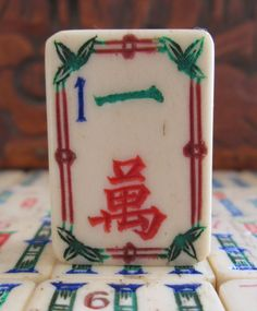 1920s bone and bamboo 1 crack mahjong tile with fancy carved border.