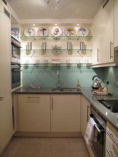 Kitchen with aqua glass splashback.