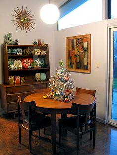 I sooo want this entire room. Mid-century modern holiday dining room.