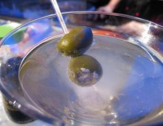 Dirty vodka martini with blue cheese olives.