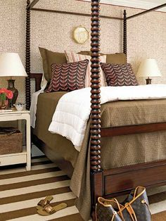 I love the striped rug, the bed posts and the mix of patterns.