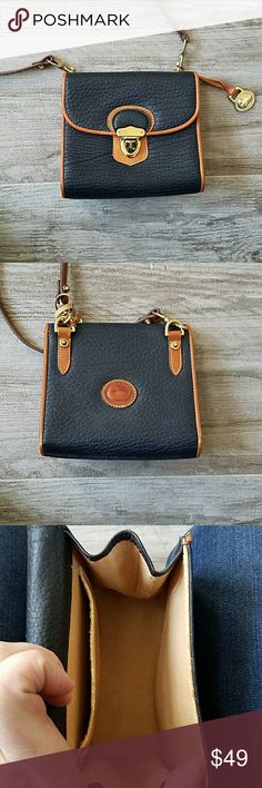 """Dooney & Bourke small crossbody bag Small navy crossbody bag.  6"""" x 6"""".  Strap is 20 inches long but can be adjusted shorter.  Like new. Dooney & Bourke Bags Crossbody Bags"""