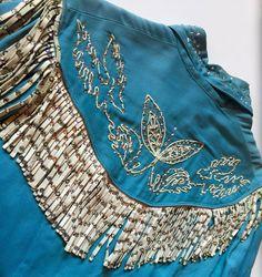 turquoise 50s western outfit with rhinestone fringing, back yoke close up