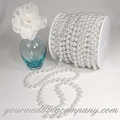 Bulk Pearl Chain - Glossy-white (also in ivory), faux-pearl garland for decorating favors, vases, DIY centerpieces, bouquets & aisle arrangements. Bulk rolls in 8mm & 10mm white or ivory pearls.  #Pearl #Chain #Garlands Pearls for a beach-theme wedding. - wedding supplies - event decorations - party supplies    http://www.yourweddingcompany.com