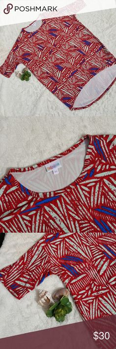 Lularoe Irma Extra Small Red and Blue Top EUC Worn once, Super Ultra Soft. Lularoe Irma extra small red and blue shirt. I just needed something a little bit larger. LuLaRoe Tops Tees - Short Sleeve