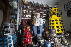 Rob Hull with his collection of Daleks, which earned him a Guinness World Record.