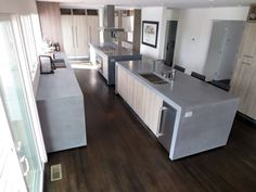 Concrete island kitchen countertops with double waterfall lags by Trueform Concrete - Design by Jo Laurie Design