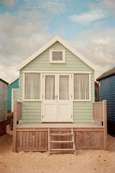 ** This looks more like a small 'real' house than a beach changing hut. Definitely a design I am interested in for my beach hut designs. I love how it looks like a home. Cabins And Cottages, Beach Cottages, Beach Houses, Mini Loft, Haus Am See, Beach Cottage Style, Tiny House Living, Living Room, Little Houses