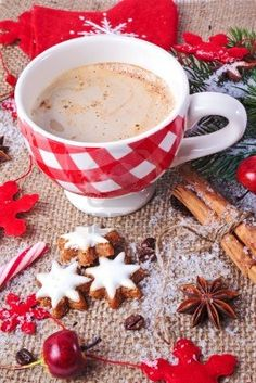christmas decoration in vintage style, cinnamon stars with checked cup of cappuchino and spices Stock Photo - 11182613