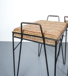 Steel wire frame stools small benches, circa 1950. Black steel wire frame bases with original upholstery. Good vintage condition, several issues present, some missing the leather handles, others have structural issues, priced as a set of four. Original midcentury pieces.