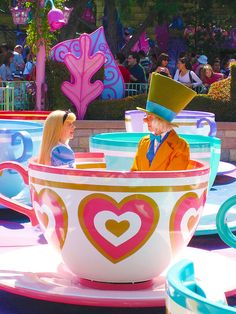Alice and The Mad Hatter on the Teacups