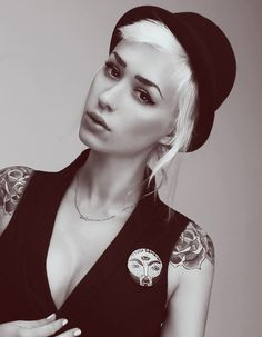 Girl female woman hat necklace short hair black and white b tattoo tattoos shoulder tattoo nose piercing blond hair blond portrait photograph