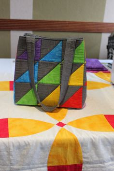 The Half Square Triangle Bag By Caroline Gunn. This is the first post on our GO! Inspiration blog. https://accuquilt.com.au/blog/half-square-triangle-bag-by-caroline-gunn/