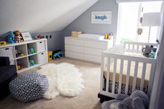 How cool is this nursery? Yellow and grey, and a trendy pouf.  Just watch a young infant on that flokati rug it is a suffocation hazard.