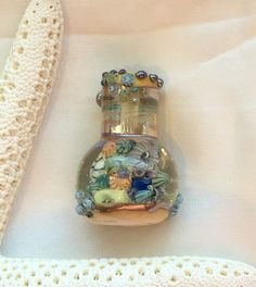 ValVaanaLampwork Handmade Glass Lampwork Bead Ocean in a Bottle for Pendant Wire Wrapping Original One of a Kind by ValVaaniaLampwork on Etsy https://www.etsy.com/listing/235406661/valvaanalampwork-handmade-glass-lampwork