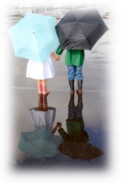 Photo by Myle Collins    Mylestone Photography  Brother and Sister in the Rain Puddles  portrait children, reflections, umbrellas, holding hands, rain boots