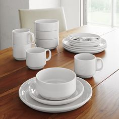 I like plates with an edge/lip like these Logan Stacking Dinner Plate | Crate and Barrel