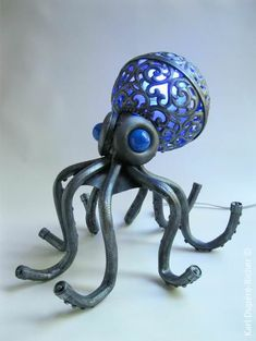 Sculptor Karl Dupere-Richer has created an octopus lamp using recycled objects like garden hoses, Christmas ornaments, and a hanging globe. More pictures of the unique lamp can be viewed at Dupere-Richer's website. Octopus Lamp, Octopus Tentacles, Cthulhu, Le Kraken, Motif Art Deco, Mood Lamps, 3d Cnc, Unique Lamps, Christmas Balls