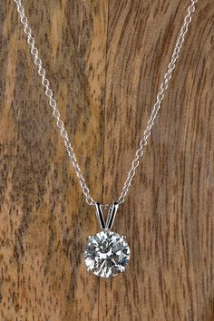 Classic style meets elegant sparkle with a timeless diamond pendant this classic diamond necklace is the perfect gift to give someone you love just because mozeypictures Choice Image
