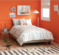 I like the bright orange walls, but how it somehow feels not too young