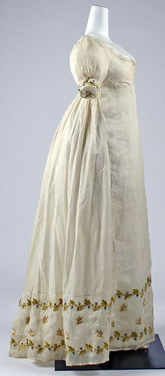 Antique Italian summer dress. Puff sleeves, empire waist, and full back skirt. Sheer ivory (voile?) with embroidered border of blueberries on vines and pink roses. Photo: Metropolitan Museum of Art.
