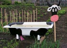 cheap yard decorations, ponds and planters made with bathtubs.