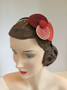 SWIRLS of red, orange, white and black leather strips on a black grosgrain ribbon and metal headband.  Handmade.