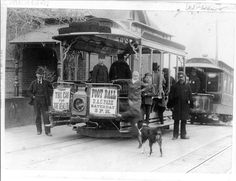 """Men and boys standing on or near streetcars bearing signs, """"Take this car for the healer,"""" and """"Foot ball D.A.C. park, Saturday 3 p.m.""""  Denver, Colorado ca. 1895."""