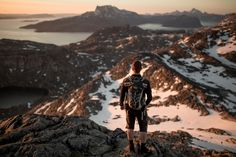 https://flic.kr/p/o4i7U9   A hiker enjoying the midnight sun over the mountains near Nuuk   Photo by Mads Pihl  Please note that the Visit Greenland B2B photo database has moved to photos.greenland.com.  Check out www.greenland.com for more adventures in the Arctic.