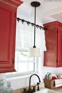 i LOVE the red cabinets! 8 ways to use tension rods:: Genius.I don't care about the tension rods, I LOVE the white walls with red cabinets! Hm Deco, Deco Champetre, Kitchen Curtains, Kitchen Windows, New Kitchen, Kitchen Ideas, Kitchen Decor, Kitchen Colors, Kitchen Designs
