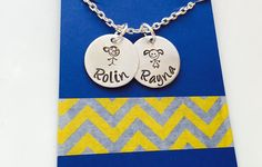 A personal favorite from my Etsy shop https://www.etsy.com/listing/242759680/childrens-name-necklace-family-necklace