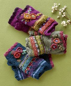 Posie Handwarmers – fleece-lined floral wool handwarmers. Posie Handwarmers – fleece-lined floral wool handwarmers.Posie Handwarmers: Our fleece-lined floral wool handwarmers add a happy note to your winter ensemble with brightly blooming flowers in a Fingerless Gloves Knitted, Knit Mittens, Hand Knitting, Knitting Patterns, Crochet Patterns, Freeform Crochet, Knit Crochet, Knitting Projects, Crochet Projects