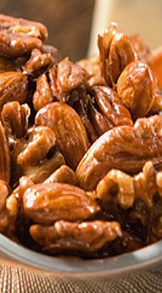 Coffee-Glazed Nuts - Walnuts, pecans and almonds combine in this tasty twist on the classic nut mix. With a sweet and savory coffee glaze, these Coffee-Glazed Nuts are sure to create a buzz (pun intended)! Trail Mix Recipes, Nut Recipes, Candy Recipes, Coffee Recipes, Holiday Recipes, Snack Recipes, Spiced Nuts, Roasted Nuts, Candied Nuts