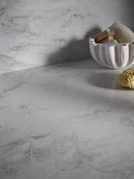 Other than Quartz that  resembles Cararra Marble is* 'Dupont CORIAN 'Raincloud'.  Has a white base with gray translucent and fine dark particles giving it a natural appearance. Recommended for areas that will take abuse.  ie: Bathroom vanity countertops, tub surround,  etc.