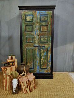 Green Vintage Door Cabinet by hammerandhandimports on Etsy, $990.00  maybe I could do this to the bookshelf?