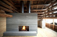 concrete fireplace in a log barn... yum.