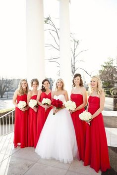 My wedding theme is going to red. Short red dresses would be super cute. I love the white flowers for the bridesmaids and red for the bride.