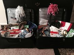 Easter Baskets made out of suitcases with stuff for traveling to Disneyland like flip flops beach towel and a magazine for the plane